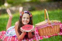 Happy smiling child eating watermelon outdoors Royalty Free Stock Image