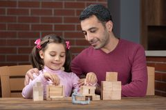 Happy Smiling Child Girl and Father Playing With Wooden Toys stock image