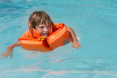 Happy smiling child girl in inflatable life-jacket Stock Images