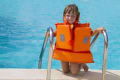 Happy smiling child girl in inflatable life-jacket Stock Photos