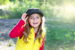 Happy smiling child girl portrait outdoors background. stock photo