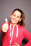 Happy smiling child giving a thumbs up stock images