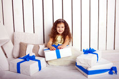 Happy smiling child holding gifts Stock Photography