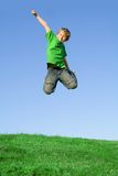Happy smiling child jumping free