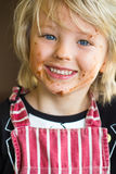 Happy, smiling child with messy chocolate face. Happy child with messy chocolate face from baking stock photography