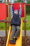 Happy smiling child in playground vertical Stock Photo