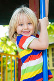 Happy, smiling child playing in a play ground royalty free stock photos
