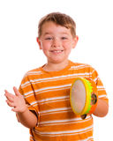 Happy smiling child playing tambourine Stock Photography