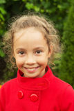 Happy smiling child in red jacket outdoors Stock Photo