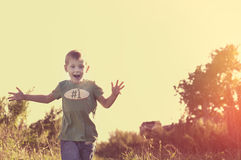 Happy smiling child running to his mom Stock Images