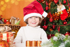 Happy smiling child in Santa`s hat Stock Images
