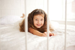 Happy smiling child waking up in the morning. Stock Images