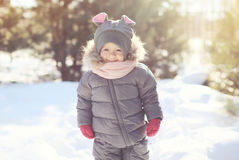Happy smiling child walking in winter day Royalty Free Stock Photography