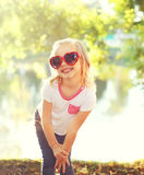 Happy smiling child wearing a sunglasses having fun in summer Royalty Free Stock Image