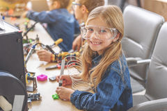 Happy smiling child in workshop Stock Images
