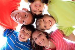 Happy smiling children. Hugging with heads together stock photos