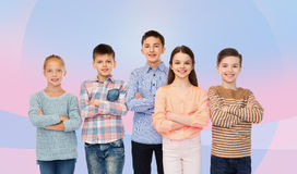 Happy smiling children with crossed hands Stock Photos