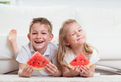 Happy smiling children eating watermelon Royalty Free Stock Images
