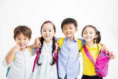 Happy smiling children hugging together. Group of happy smiling children hugging royalty free stock images