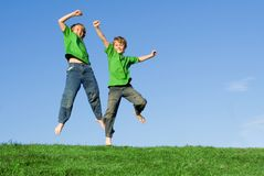 Happy smiling children jumping. For joy royalty free stock photos