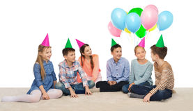 Happy smiling children in party hats on birthday Royalty Free Stock Image