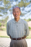Happy Smiling Chinese Senior Standing Outdoor Royalty Free Stock Images