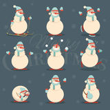 Happy smiling christmas snowman cartoon character in various pos Royalty Free Stock Image