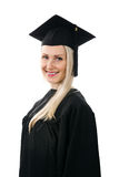 Happy smiling college graduate wearing gown on white Stock Photography