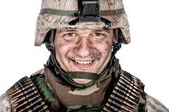 Happy smiling commando soldier in combat helmet royalty free stock image