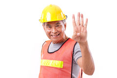 Happy, smiling construction worker pointing up 4 fingers gesture Royalty Free Stock Photos