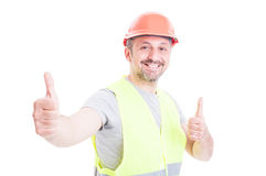Happy smiling constructor or builder showing double like sign Royalty Free Stock Photos