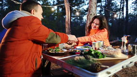 Happy smiling couple in the autumn forest on the picnic. Evening. Couple at a picnic holding hands stock video footage
