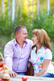 Happy smiling couple in the autumn forest on the picnic Stock Photo