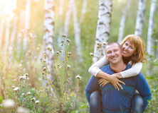 Happy smiling couple in the autumn forest Royalty Free Stock Photography