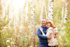Happy smiling couple in the autumn forest Royalty Free Stock Images