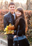 Happy smiling couple in autumn outdoors Stock Photos
