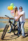 Happy smiling couple with balloons Stock Photo
