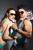 Young fashionable couple on studio background. Happy smiling couple in beach clothes on dark studio background Stock Photo