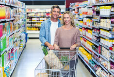 Happy smiling couple doing shopping Stock Photography