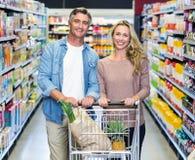 Happy smiling couple doing shopping Royalty Free Stock Image