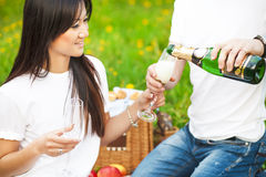 Happy smiling couple drinking champagne at picnic Stock Photo