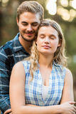 Happy smiling couple embracing with eyes closed Stock Images