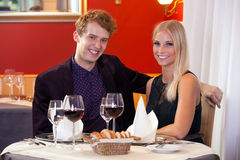 Happy smiling couple enjoying a night out Stock Image