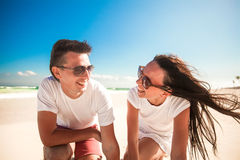 Happy smiling couple on exotic white beach looking Royalty Free Stock Image