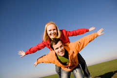 Happy smiling couple fly in sky Royalty Free Stock Images