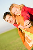 Happy smiling couple fly in sky Stock Image