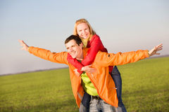Happy smiling couple fly in sky Royalty Free Stock Image