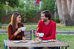 Happy smiling couple having lunch Royalty Free Stock Photography