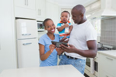 Happy smiling couple with his babyboy using digital tablet Stock Images