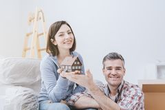 Couple building their house stock photos